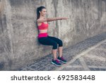 young fashionable sportswoman... | Shutterstock . vector #692583448