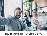 happy friends business partners ...   Shutterstock . vector #692589670