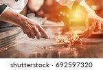 hand of man take cooking of... | Shutterstock . vector #692597320