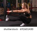 fitness woman doing pistol... | Shutterstock . vector #692601430