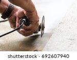 Worker Grind Hard Floor. Worke...