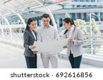 three people are business... | Shutterstock . vector #692616856