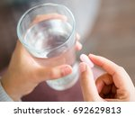 closeup woman hand with pills... | Shutterstock . vector #692629813