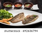 grilled sea bass served with... | Shutterstock . vector #692636794