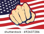 punching fist hand with usa... | Shutterstock .eps vector #692637286