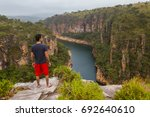 man standing on a rock... | Shutterstock . vector #692640610