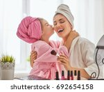 happy loving family. mother and ... | Shutterstock . vector #692654158