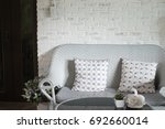 cozy blue rattan sofa with... | Shutterstock . vector #692660014