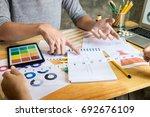 two young women working as... | Shutterstock . vector #692676109