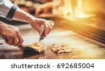 hand of man take cooking of... | Shutterstock . vector #692685004