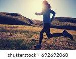 young fitness woman runner... | Shutterstock . vector #692692060