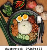 nasi lemak is a commonly found... | Shutterstock . vector #692696638