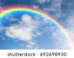 blue sky with clouds and rainbow   Shutterstock . vector #692698930