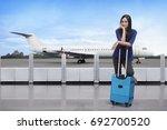 traveler asian woman standing... | Shutterstock . vector #692700520