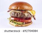 gourmet cheeseburger with fried ... | Shutterstock . vector #692704084