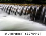 small waterfall on mountain... | Shutterstock . vector #692704414