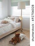 dolls on bed in kid s bedroom ... | Shutterstock . vector #692706028