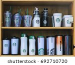Small photo of KUALA LUMPUR, MALAYSIA - AUGUST 05, 2017 : Starbucks drinkware. Assortment of Starbucks branded and logo drinkware including season's cups, Cold Cups, Mugs, Travel Mugs, Water Bottles And Tumblers.