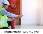 male professional checking a... | Shutterstock . vector #692712490