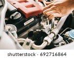 auto mechanic repair engine in... | Shutterstock . vector #692716864