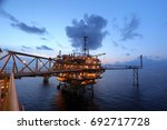 offshore oil rig in the middle... | Shutterstock . vector #692717728