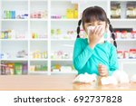 asian kid with the tissue  she... | Shutterstock . vector #692737828