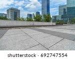 empty brick floor with modern... | Shutterstock . vector #692747554
