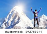 hiker with backpacks reaches... | Shutterstock . vector #692759344