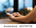 hand of woman using smartphone... | Shutterstock . vector #692759728