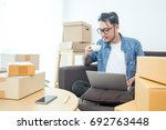young asian man working at home ...   Shutterstock . vector #692763448