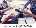 female employee taking payment... | Shutterstock . vector #692765044
