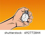 male hand holding stopwatch.... | Shutterstock .eps vector #692772844