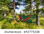 camping in woods with hammock... | Shutterstock . vector #692775238