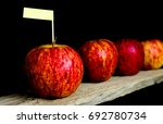 red apples and yellow label put ... | Shutterstock . vector #692780734