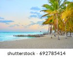 peaceful north beach with palm... | Shutterstock . vector #692785414