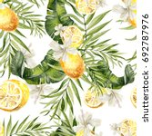 Stock photo beautiful watercolor seamless tropical jungle floral pattern background with palm leaves hibiscus 692787976