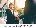 business people shaking hands... | Shutterstock . vector #692790100