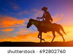 silhouette cowboy and horse on... | Shutterstock . vector #692802760