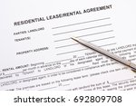 rental agreement on paper with... | Shutterstock . vector #692809708