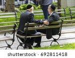 two jewish men wearing kippah... | Shutterstock . vector #692811418