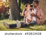 happy african american... | Shutterstock . vector #692813428