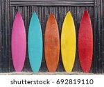 Colored Surfboards Leaning Up...