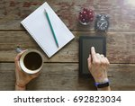 freelancer works with a tablet... | Shutterstock . vector #692823034