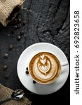 coffee latte art on wooden table   Shutterstock . vector #692823658
