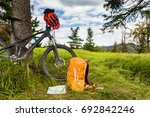 Mountain biking equipment in the woods, bikepacking adventure trip in green mountains. Travel campsite and MTB cycling with backpack, wilderness forest in Poland. - stock photo