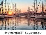 beautiful sailboats moored in... | Shutterstock . vector #692848660