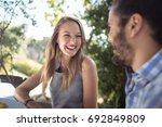 happy couple interacting with... | Shutterstock . vector #692849809