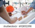 engineer sketching...   Shutterstock . vector #692852398