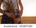 modern girl holding wheat and... | Shutterstock . vector #692857180