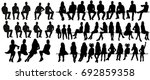 isolated silhouette of sitting ... | Shutterstock . vector #692859358